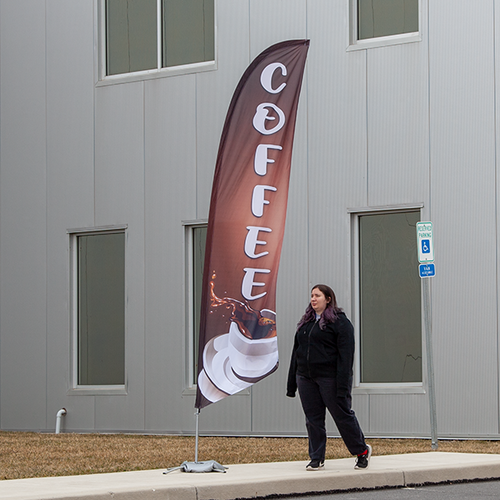 Add a feather flag to your outdoor advertising to boost exposure