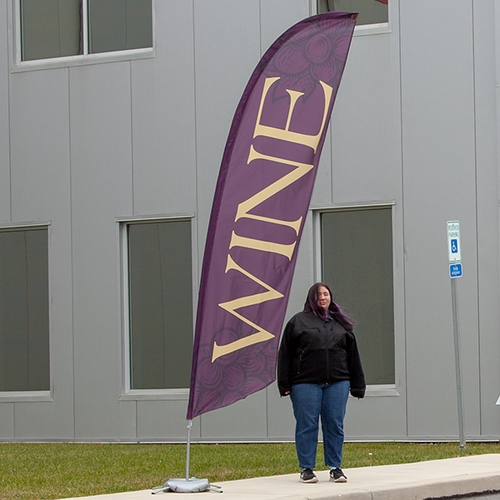 Wine feather flag displayed outdoors