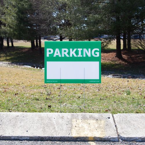 Green sign stakes into the ground for outdoor advertising