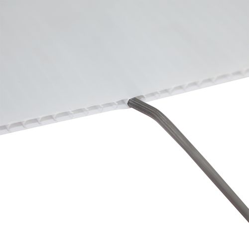 Included stakes are inserted into the flutes of the corrugated plastic