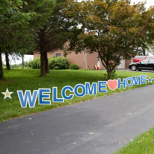 Welcome home signs in yard