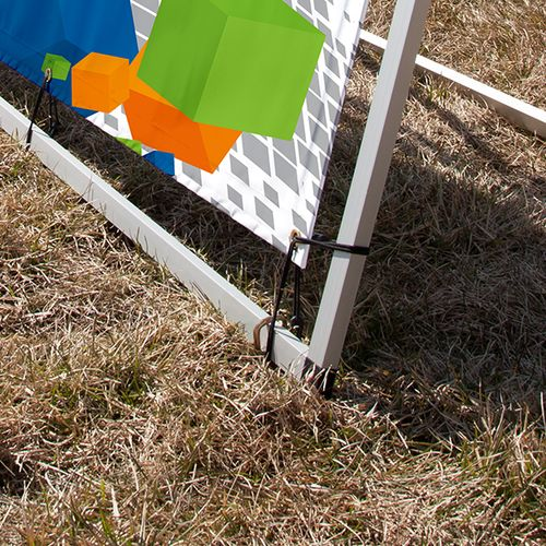 Use included stakes on uneven surfaces on to keep frame upright